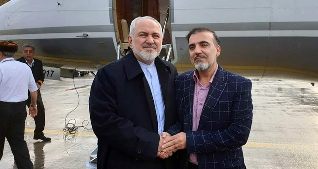 A handout picture on the Iranian Foreign Minister's official Twitter account on Dec. 7, 2019, shows Foreign Minister Mohammad Javad Zarif L and Iranian scientist Massoud Soleimani standing by a plane at an undisclosed location. AFP Photo