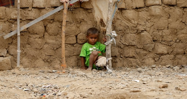 A boy sits in an improvised camp near Abs in the northwestern province of Hajja, Feb. 18, 2019.
