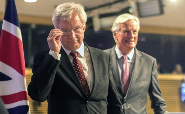 European Union chief Brexit negotiator Michel Barnier, right, and British Secretary of State for Exiting the European Union David Davis leave after a media conference at EU headquarters in Brussels yesterday.