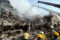 25 still missing in Tehran building collapse killing 20 firemen