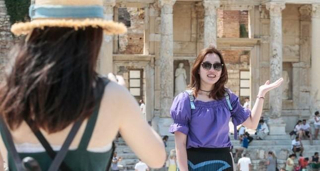 A tourist poses at the ancient site of Ephesus in western Turkey's Izmir province. AA Photo