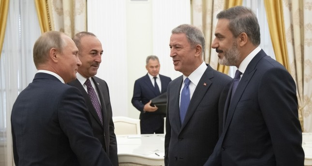 (From left to right) Russian President Vladimir Putin, Foreign Minister Mevlüt Çavuşoğlu, Defense Minister Hulusi Akar and intelligence chief Hakan Fidan talk to each other during their meeting in the Kremlin, Moscow, Aug. 24.