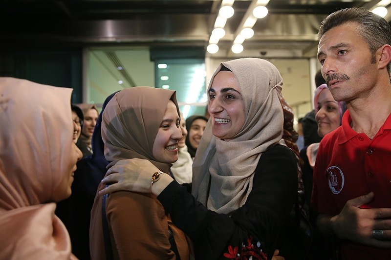Ebru u00d6zkan greeted by family and friends as she arrives in Istanbul in the early morning hours of July 16, 2018. (AA Photo)