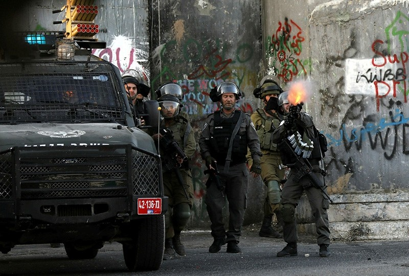 Israeli army soldiers shoot tear gas at Palestinian protesters during clashes followed a protest in the West Bank city of Bethlehem July 19, 2017. (EPA Photo)