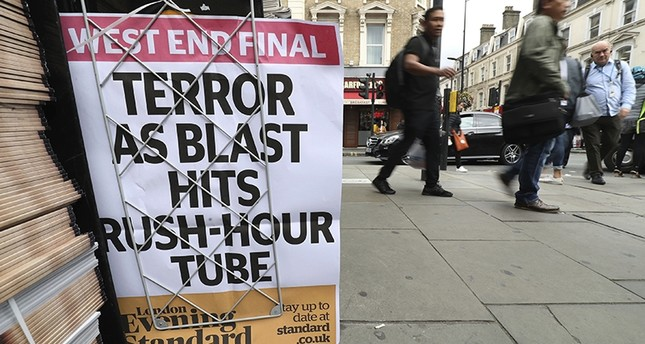 A London evening newspaper stand displays their headline outside Paddington tube station in London, after a terrorist incident was declared at Parsons Green subway station Friday, Sept. 15, 2017. (AP Photo)