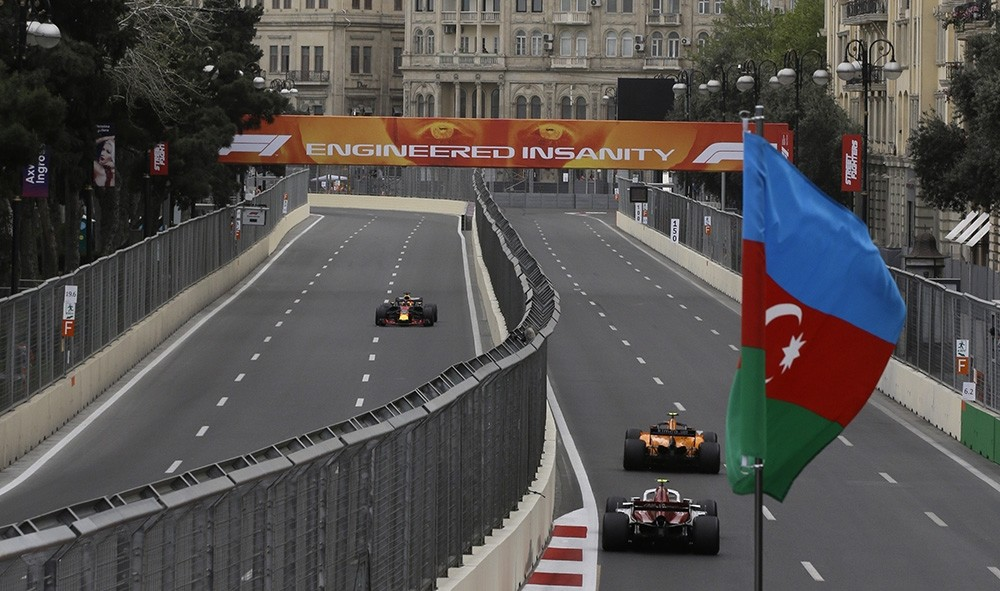 In this Saturday, April 28, 2018 file photo, cars race during the third free practice session at the Baku Formula One city circuit, in Baku, Azerbaijan. (AP Photo)