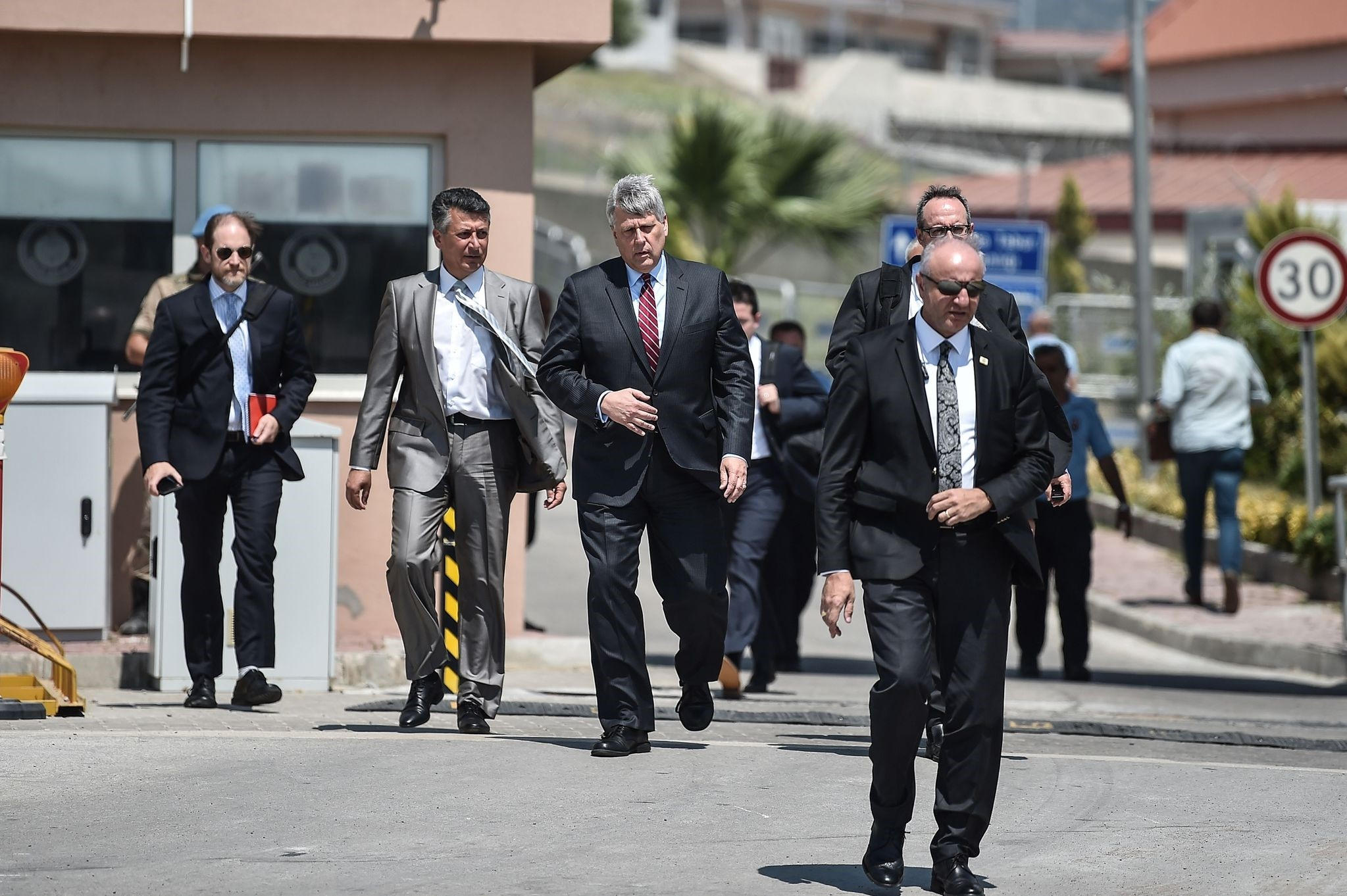 U.S. Charge du2019Affairs Philip Kosnett, third from left, leaves after the trial of U.S. Pastor Andrew Brunson who has been detained in Turkey for over a year on terrorism charges, Aliau011fa, u0130zmir, July 18.