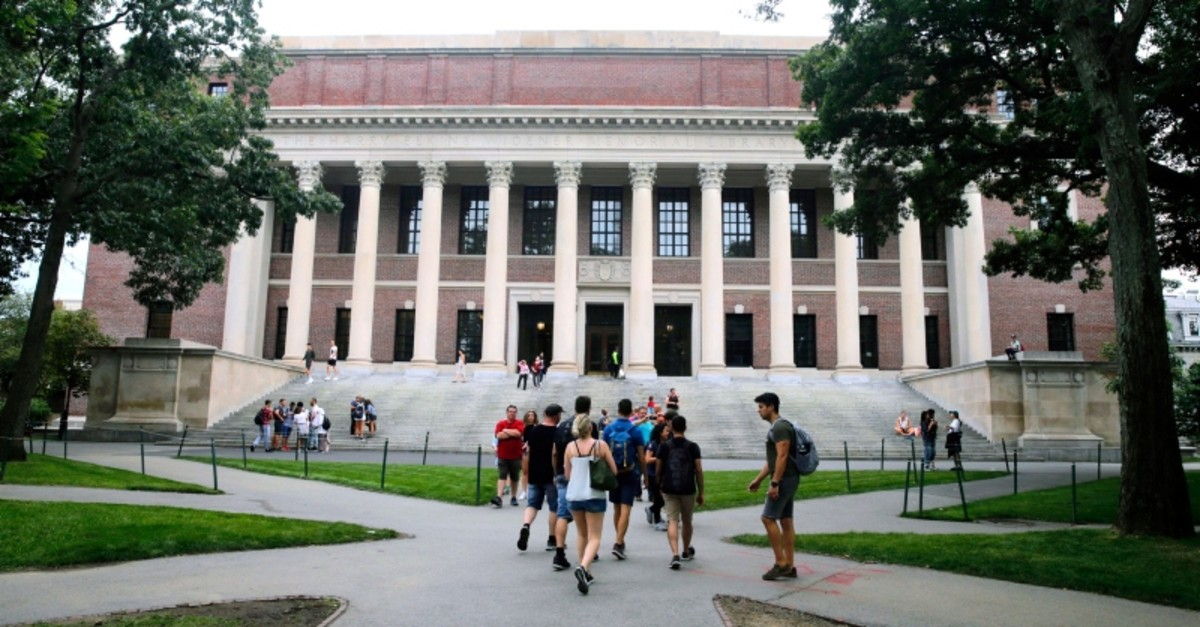 In this Aug. 13, 2019 file photo, students walk near the Widener Library in Harvard Yard at Harvard University in Cambridge, Mass. (AP Photo)