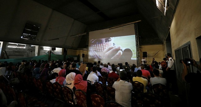 Palestinians watch the film 10 Years at al-Samer Cinema in Gaza City, August 26, 2017. (REUTERS Photo)