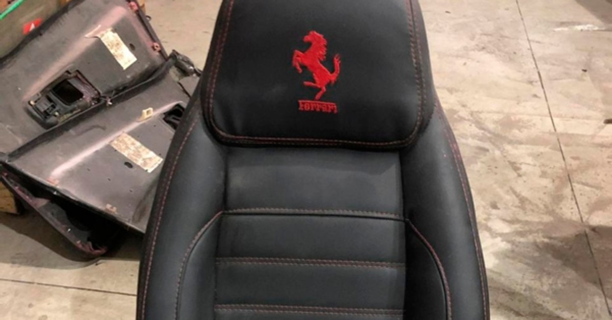 This July 15, 2019 photo released by Itajai Civil Police shows the seat of a car embroidered with a fake Ferrari logo,  inside a workshop in Itajai, Brazil (AP Photo)