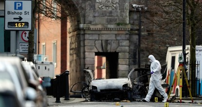 Northern Ireland police arrest four men over car bomb attack