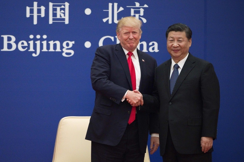U.S. President Trump (L) and China's President Xi shake hands during a business leaders event at the Great Hall of the People in Beijing, Nov. 9, 2017.