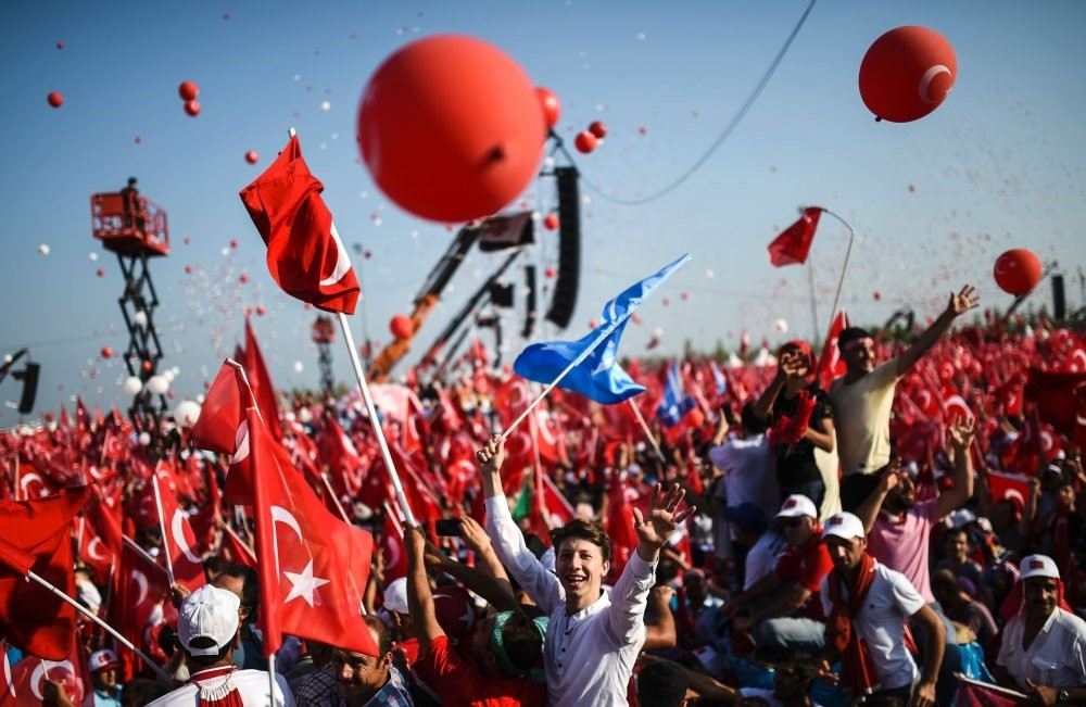 People wave Turkish flags during a rally against the July 15 coup attempt where government officials and opposition party members attended to condemn the heinous attempt, Yenikapu0131, Istanbul, Aug. 7, 2016.