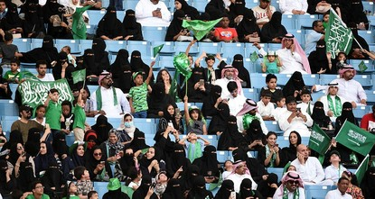 pHundreds of women thronged a sports stadium for the first time to mark Saudi Arabia's national day Saturday, celebrated across the conservative kingdom with a raucous display of concerts, folk...