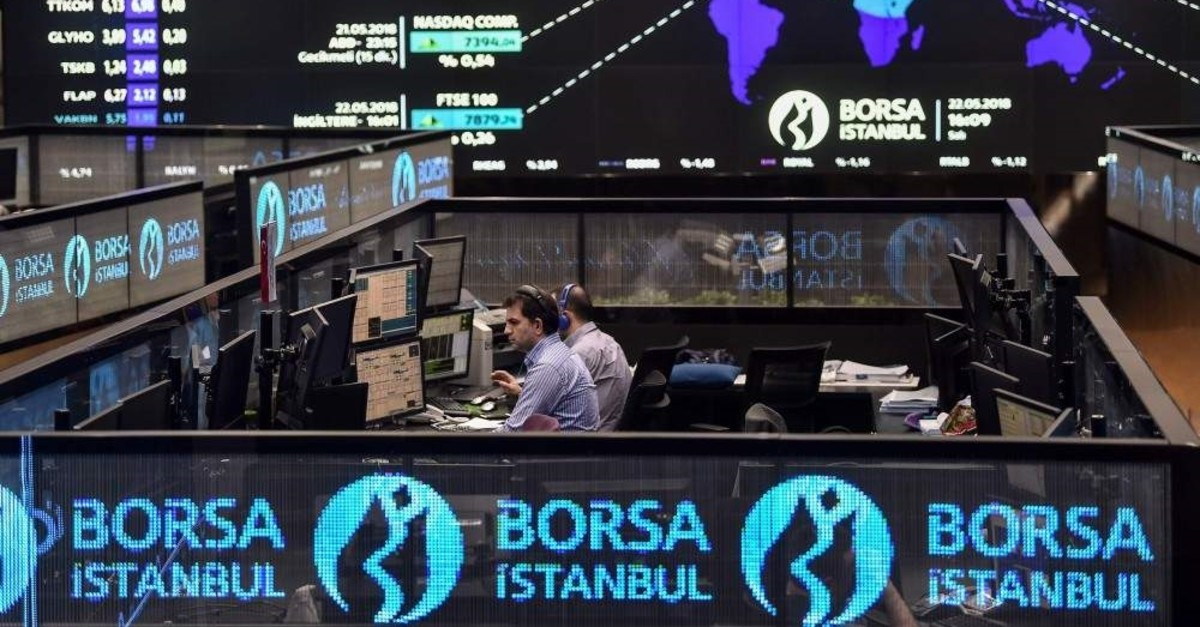 Traders work at their desks on the floor of the Borsa Istanbul, May 22, 2018. (AFP File Photo)