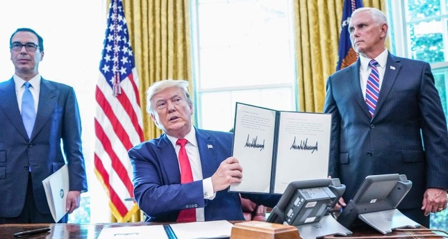U.S. President Donald Trump meets with Vice President Mike Pence (R) and Secretary of Treasury Steven Mnuchin at the White House on June 24, 2019, before signing 'hard-hitting sanctions' on Iran's supreme leader. (AFP Photo)