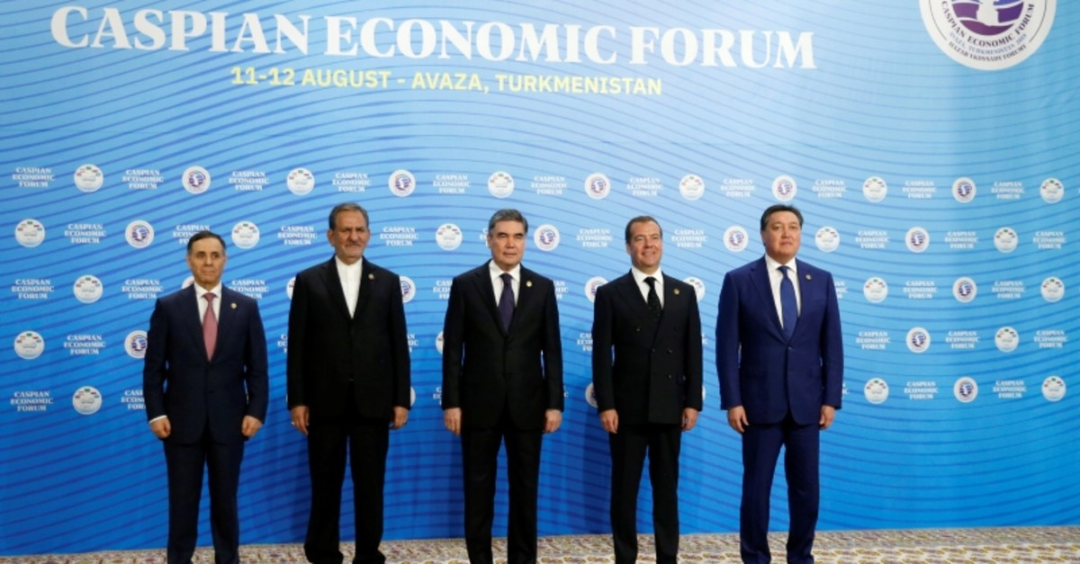 (L-R) Azerbaijani PM Novruz Mammadov, Iran's VP Eshaq Jahangiri, Turkmen President Gurbanguly Berdimuhamedov, Russian PM Dmitry Medvedev and Kazakh PM Askar Mamin pose for a photo in Turkmenbashi. (Sputnik/Dmitry Astakhov/Pool via Reuters)