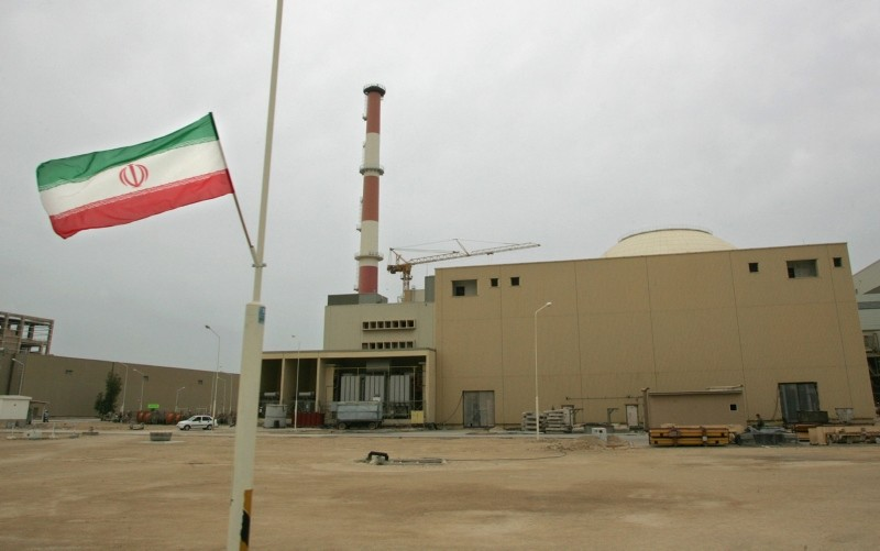 In this file photo taken on April 03, 2007 an Iranian flag is seen outside the building housing the reactor of the Bushehr nuclear power plant, in the Iranian port town of Bushehr, 1200 kms south of Tehran. (AFP Photo)