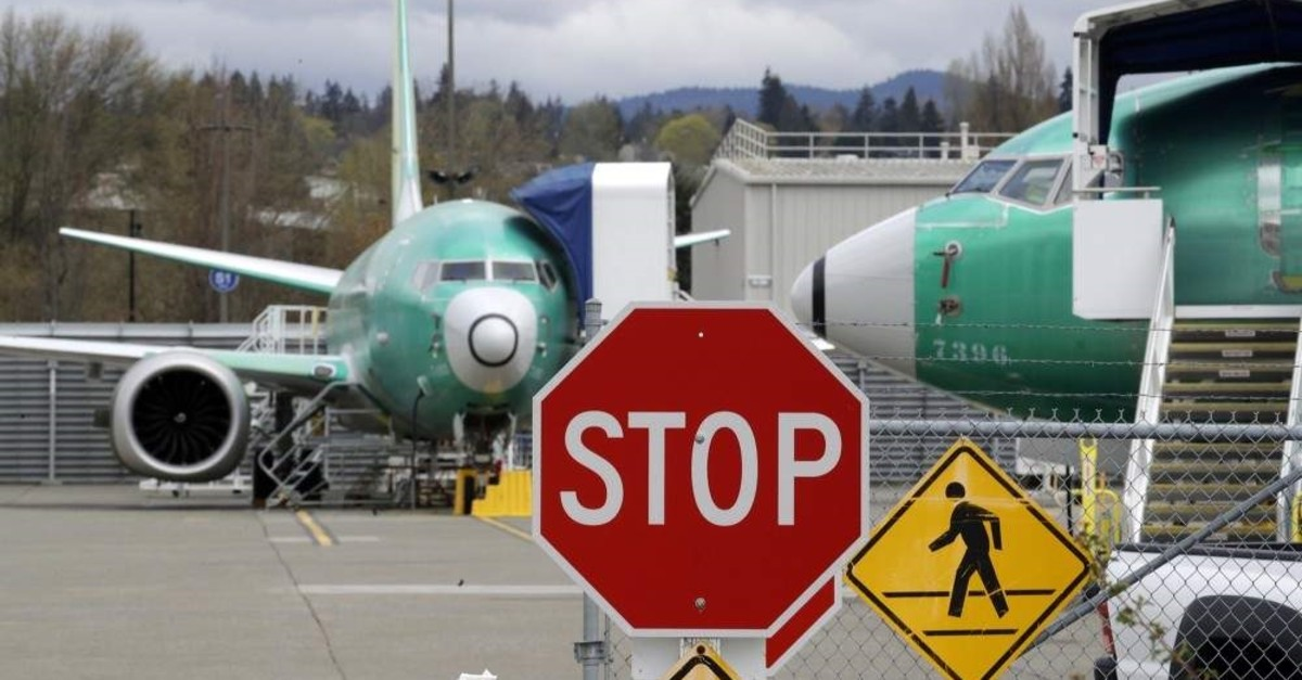In this April 8, 2019, file photo Boeing 737 Max 8 jets are parked behind a stop sign at a Boeing Co. production facility in Renton, Wash. (AP Photo)