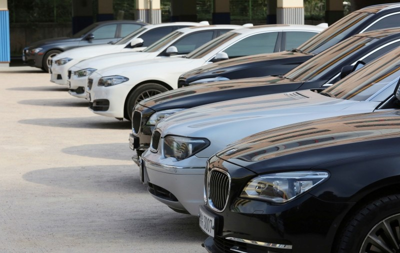 BMW cars are parked for emergency safety check up at the playground of an elementary school near a BMW service center in Seoul, South Korea, Tuesday, Aug. 14, 2018. (AP Photo)