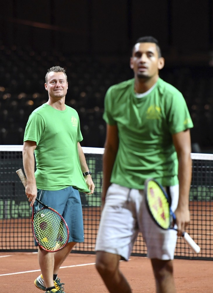Team Australia's Nick Kyrgios (R), and team captain Lleyton Hewitt participate in a practice session prior to the Davis Cup World Group tennis semifinal in Brussels.