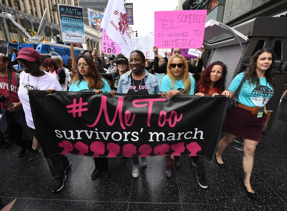 Women survivors of sexual harassment and their supporters protest during a #MeToo march in Hollywood, California.