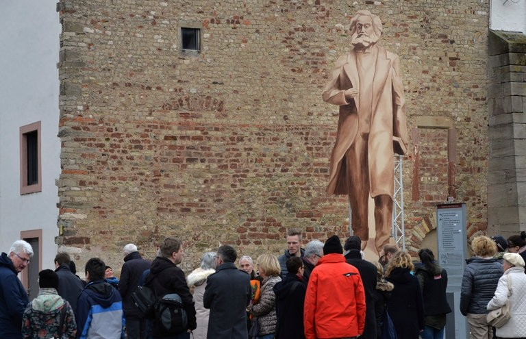The city of Trier, Germany has decided to accept a statue of Karl Marx from China. This wooden representation shows Trier residents how the statue would look. (AP Photo)