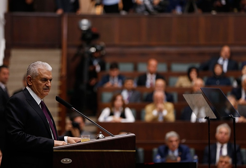 Prime Minister Binali Yu0131ldu0131ru0131m addresses the AK Party group in the Turkish parliament on Tuesday Oct. 10, 2017 (AA Photo)