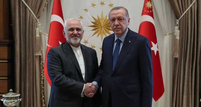 Photo released by the Turkish presidential press service on April 17, 2019, shows President Recep Tayyip Erdoğan shaking hands with Iranian Foreign Minister Mohammad Javad Zarif (L) in Ankara, Turkey. (AFP Photo)