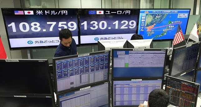 Quotation boards display the foreign exchange rate against the US dollar (L) and Euro (C) at a foreign exchange brokerage in Tokyo on August 29, 2017, after a missile was launched by North Korea earlier in the day. (AFP Photo)