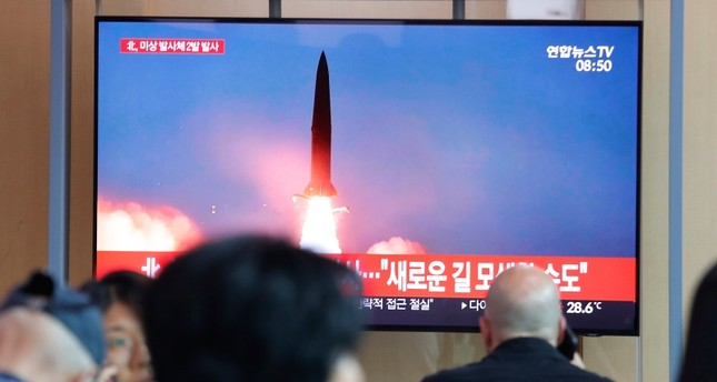 People watch a TV showing a file image of a North Korea's missile launch during a news program at the Seoul Railway Station in Seoul, South Korea, Tuesday, Aug. 6, 2019. AP Photo
