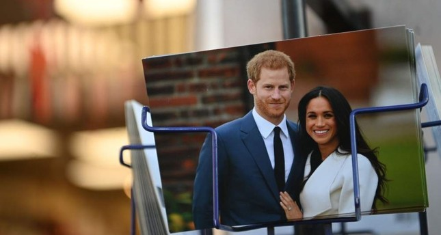 Royal memorabilia featuring Britain's Prince Harry and Meghan Markle is displayed for sale in a store near Buckingham Palace, London, Jan. 10, 2020. AFP Photo