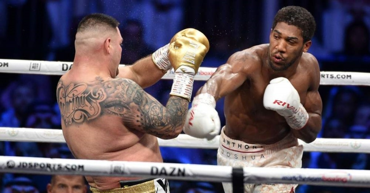 Anthony Joshua (R) competes with  Andy Ruiz Jr (L) during the heavyweight boxing match, Ad Diriya, Dec. 7, 2019.  (AFP Photo)