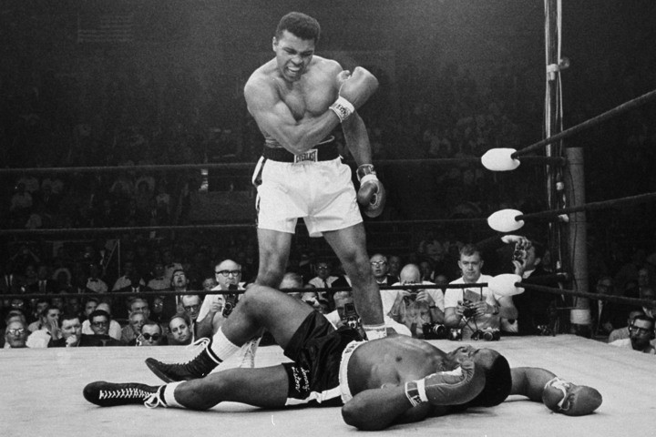 In this May 25, 1965, file photo, heavyweight champion Muhammad Ali, then known as Cassius Clay, stands over challenger Sonny Liston, shouting and gesturing shortly after dropping Liston with a short hard right to the jaw, in Lewiston, Maine.