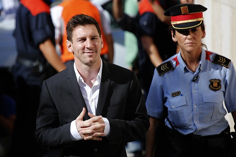 In this Sept. 27, 2013 file photo, FC Barcelona soccer player Lionel Messi, left, arrives at a court to answer questions in a tax fraud case in Gava, Spain. (AP Photo)