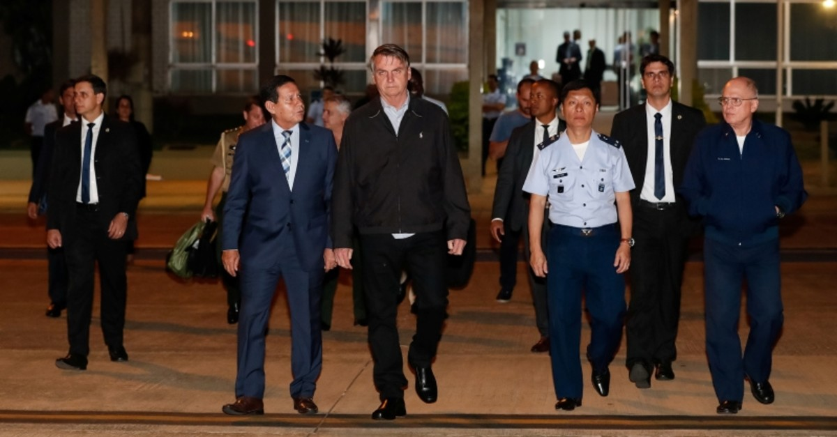 Brazil's President Jair Bolsonaro walks before his trip to Japan for this week's G20 meeting at the Air base in Brasilia, Brazil June 25, 2019. (Reuters Photo)