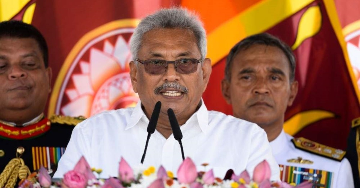 Sri Lanka's new president, Gotabaya Rajapaksa (C), speaks after taking the oath of office during his swearing-in ceremony at the Ruwanwelisaya temple, Anuradhapura, Nov. 18, 2019. (AFP Photo)