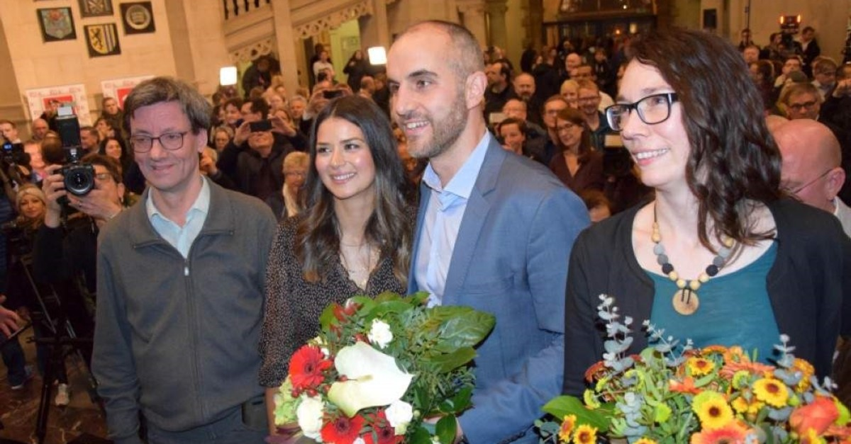 German-Turkish politician Belit Onay (second right) was elected mayor of Hannover. (AA Photo)