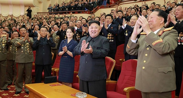 Kim Jong Un claps during a celebration for nuclear scientists and engineers who contributed to a hydrogen bomb test, in this photo released by North Korea's KCNA in Pyongyang on September 10, 2017. (REUTERS Photo)