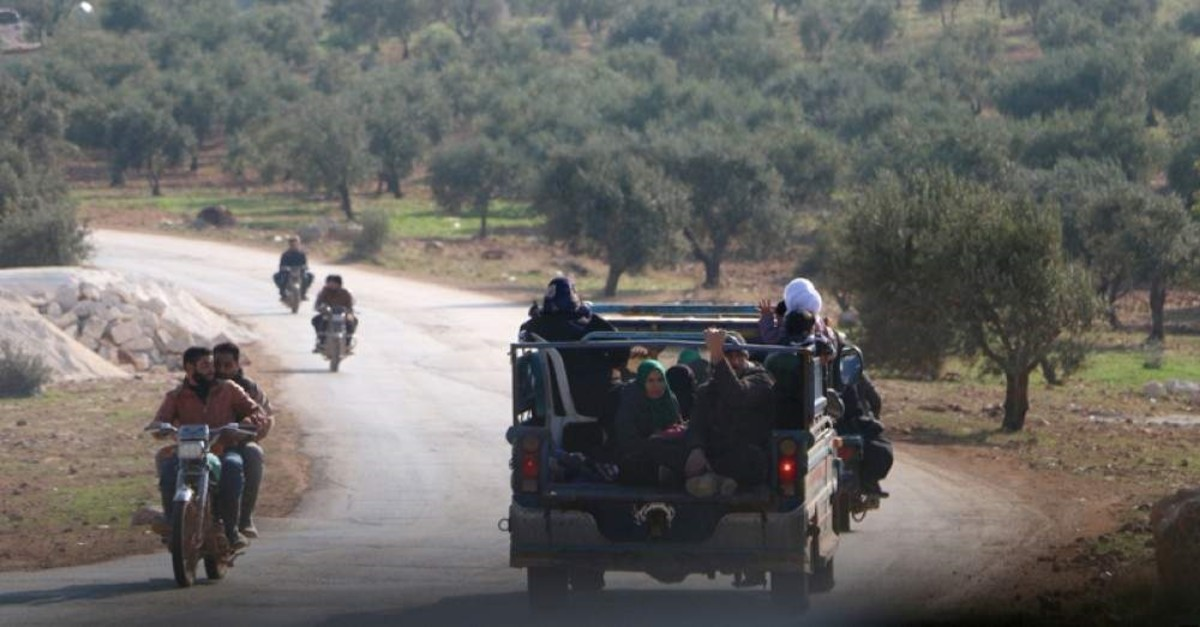 Syrians families flee to safer areas after air strikes in Syria's Idlib. (AA Photo)