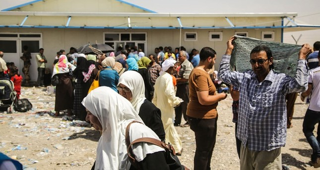 600 families flee their homes as fighting rages in northern Iraq