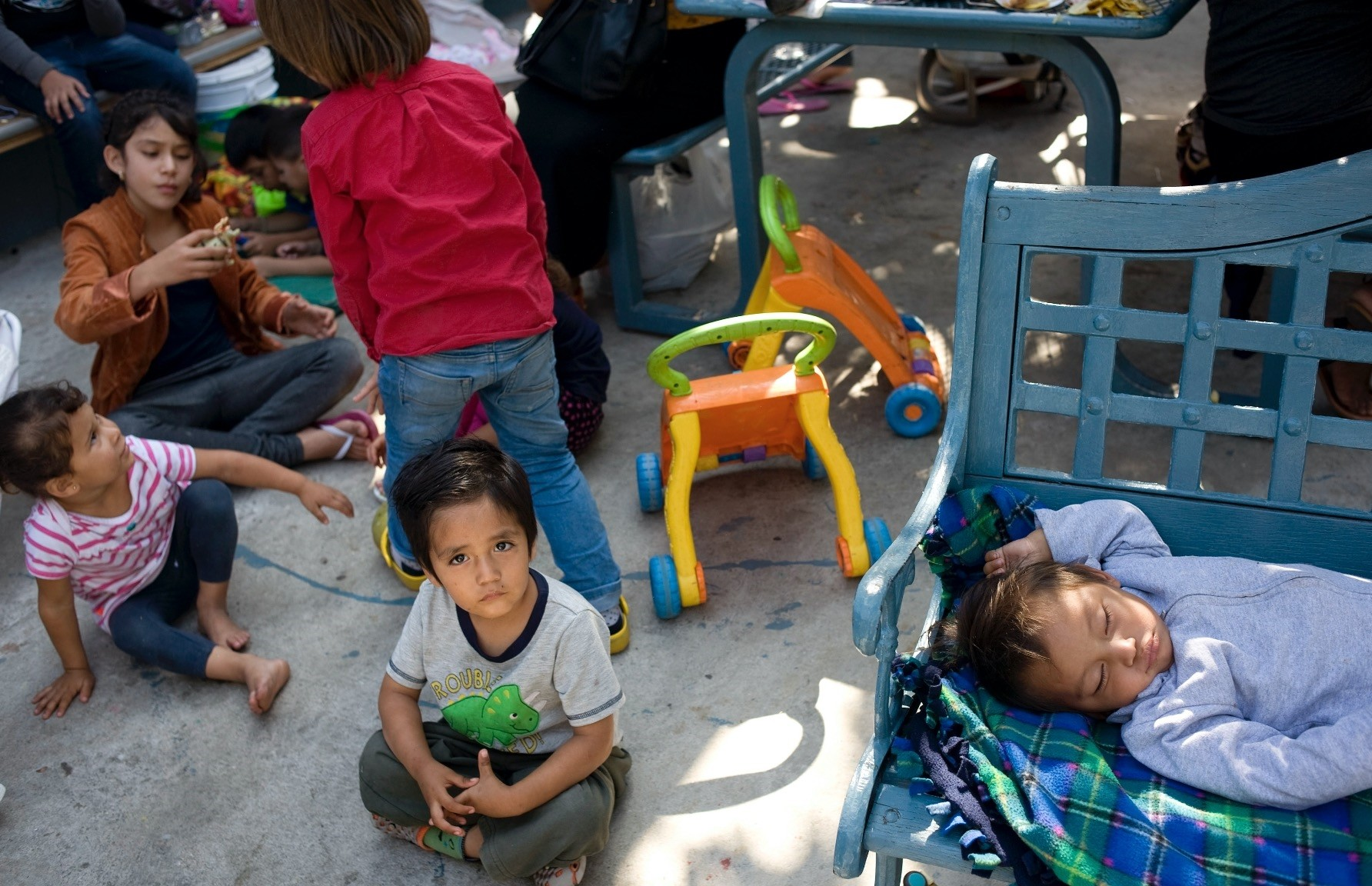 A child from the Mexican state of Michoacan looks on while sitting in the patio of the Centro Madre Assunta, Tijuana, June 20.