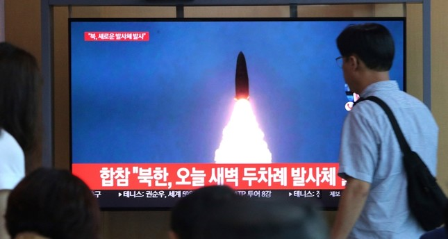 People watch a TV showing a file footage of a North Korea's missile launch during a news program at the Seoul Railway Station in Seoul, South Korea, Friday, Aug. 2, 2019. AP Photo