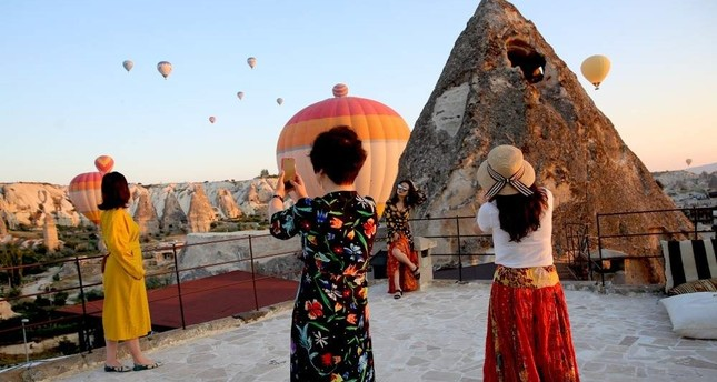With its famous underground cities and its fairy chimney volcanic cones and hot air balloon trips, Turkey's Cappadocia enjoys increasing popularity among foreign visitors all over the world. AA Photo