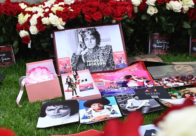Pictures and flowers placed by fans gathered outside Michael Jackson's final resting place at the Holly Terrace mausoleum in Glendale, California to remember the King of Pop on the 10th anniversary of his death, June 25, 2019. AFP Photo