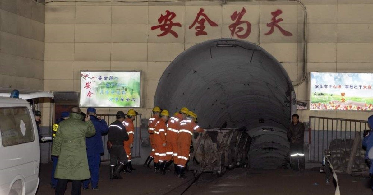 Rescuers enter a coal mine that was the site of a gas explosion in Pingyao county in northern China's Shanxi Province, Nov. 19, 2019. (Xinhua via AP)
