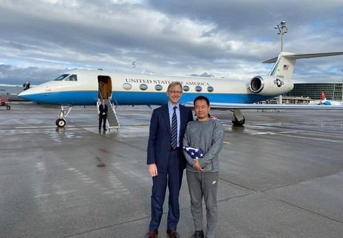 U.S. special representative for Iran Brian Hook stands with Xiyue Wang in Zurich, Switzerland on Dec. 7, 2019. (U.S. State Department via AP)