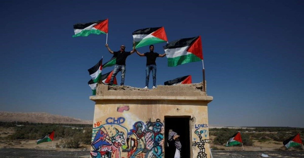 Demonstrators hold Palestinian flags near the Dead Sea in the occupied West Bank, Sept. 28, 2019. (REUTERS Photo)