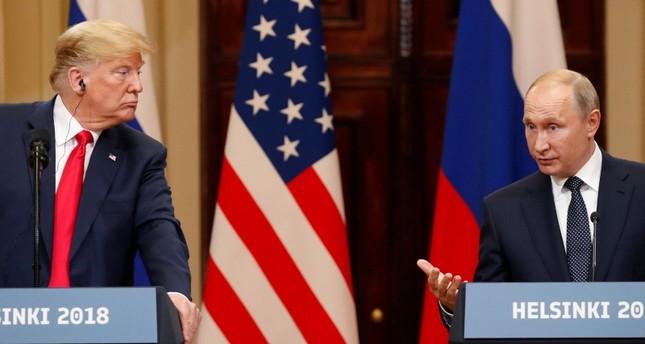 بوتين وترامب خلال مؤتمر صحفي مشترك بالعاصمة الفنلندية هلسينكي 16 يوليو 2018 (EPA)