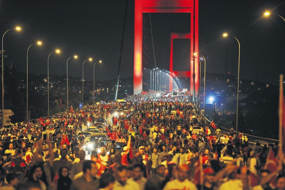 People walk over the Bosporus Bridge, now called the July 15 Martyrs' Bridge, in protest of FETu00d6's deadly coup attempt, Istanbul, July 21.